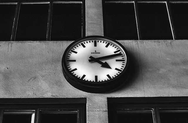 A clock hanging from the side of a building